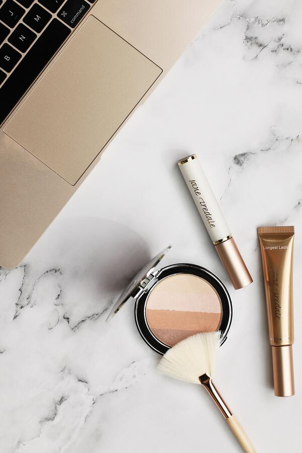 add glow to your cheeks by applying Moonglow Bronzer as a highlighter